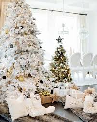 white and gold tree decorations ne wall