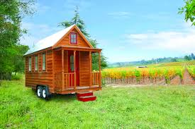 exterior design classic tumbleweed tiny house with paint front door