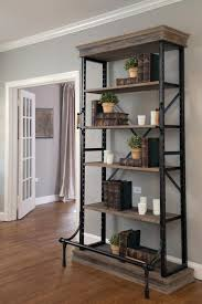 joanna gaines design book substantial wood and metal shelving with an antique look and