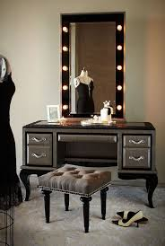 vanity glass top makeup table with tall lighted mirror and bedroom