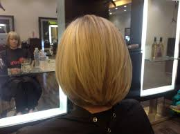 long layered bob with pattern matching highlights by andre aronica