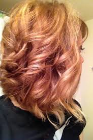 curly hair with lowlights copper lowlights blonde highlights curly swing bob hair by