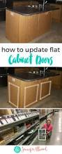 Adding Trim To Plain Cabinets by How To Add Dimension To Flat Cabinet Doors A Cabinet Makeover Idea