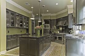 dark gray kitchen cabinets dark gray cabinets and green walls