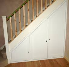 interior modern neat storage under stair setting with shoes hide