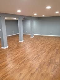 Install Laminate Flooring In Basement Our Basement With Resort Teak By Shaw Laminate Flooring Completed