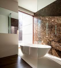 veined granite bathroom modern with free standing tub handle
