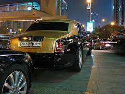 roll royce black black and gold rolls royce phantom a black and gold two to u2026 flickr
