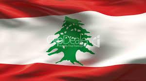 Pine Tree Flag Creased Lebanon Flag In Wind Slow Motion Lizenzfreie Stock