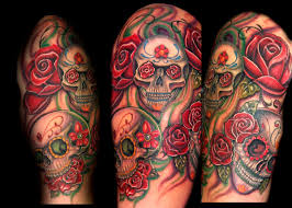 half sleeve sugar skull n roses tattoo on arm tattooshunt com
