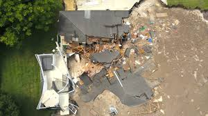 watch growing sinkhole swallows 2 houses 1 boat in florida
