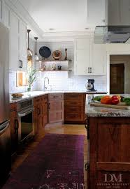design manifest kitchen stained wood base white wall cabinets love this craftsman kitchen by naomi