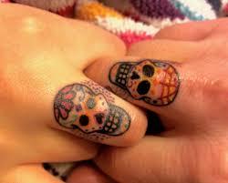 sugar skull finger tatts shame finger tatts wear so