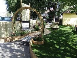 circular wooden arch at garden entrance southfield primary