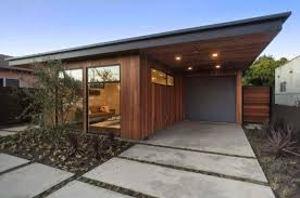mid century modern style house with concrete porch timeless mid