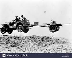 small jeep white the new u0027jeep u0027 in mid air as it pulls a small artillery piece ca