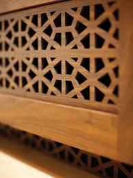 air vents are cleverly concealed by custom laser cut walnut in a