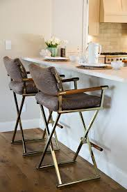vintage brass folding bar stools with brown linen cushions
