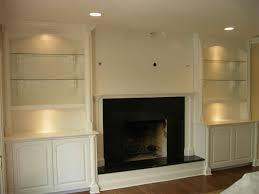 Built In Bookshelves Fireplace by Tv Over Fireplace With Raised Hearth And Built Ins Fireplace And