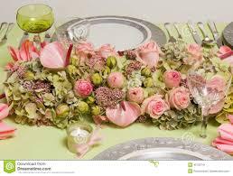 festive flower arrangement on dinner table stock image image