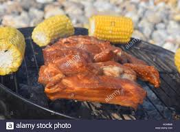 Outdoor Barbecue Raw Juicy Ribs Marinated Cooking On An Outdoor Barbecue With Stock