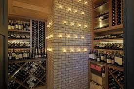 basement incredibles trap door wine cellar with wall lighting and