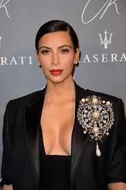 kim kardashian shares throwback photos to wish carine roitfeld