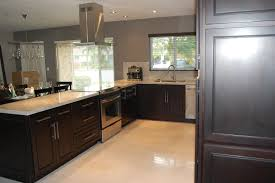 grey espresso kitchen cabinets with white island on stained