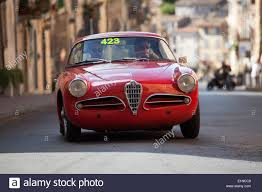 2014 mille miglia classic car rally in italy a 1956 red alfa