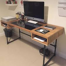 industrial design desk with steel pipe legs and an embedded