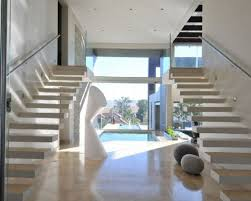 Stainless Steel Stairs Design Large Framed Glass Wall Designed Beside Spiral Stainless Steel