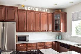 how to decorate space above kitchen cabinets decorating above kitchen cabinets craving some creativity