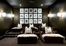 fantastic movie room design with black walls paint color
