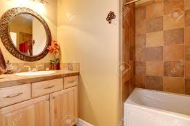 Trim For Bathroom Mirror by Warm Tones Bathroom Interior With Tile Wall Trim And Maple Vanity
