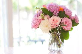 flower table bouquet of flowers on table near window photograph by