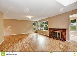 empty living room interior with brick fireplace and hardwood floor