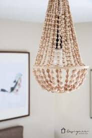 Making Chandeliers How To Make A Wood Bead Chandelier Wood Bead Chandelier Beaded