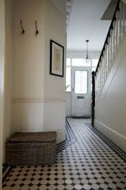 natural light floor l wonderful chequered tiles in the entryway lots of natural light