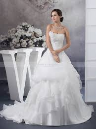 flower adorned strapless wedding dress with beaded bust