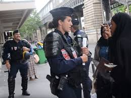 french policeman filmed ridiculing weeping refugee woman after her
