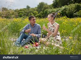 beautiful couple outdoors romantically holding handsyoung stock
