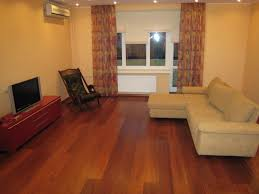 Decorating With Area Rugs On Hardwood Floors by Living Room Hard Wood Floor Brick Fireplace White Sofa Area Rugs