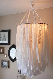 how to make a birdcage chandelier light up the room with these diy chandeliers