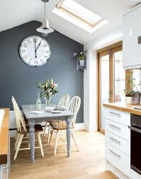 tonal grey kitchen diner with painted farmhouse furniture and roof