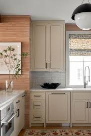 kitchen cabinets with silver handles light taupe kitchen cabinets with silver mini brick tiles