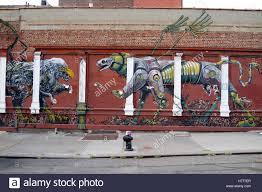 graffiti wall mural street art along meserole st in the east stock graffiti wall mural street art along meserole st in the east williamsburg brunswick section of brooklyn new york city usa