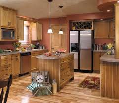 rattan kitchen furniture starmark cabinetry bridgeport door style in cherry finished in