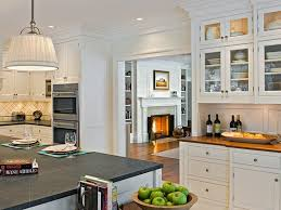 nice white hang lamp kitchen cabinets with soapstone countertops