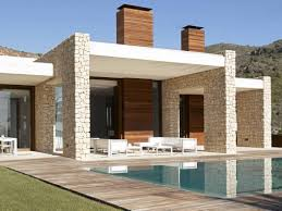 modern and small swimming pool in backyard with terrace and white