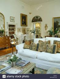living room groups tapestry cushions on sofa with white loose cover in white country